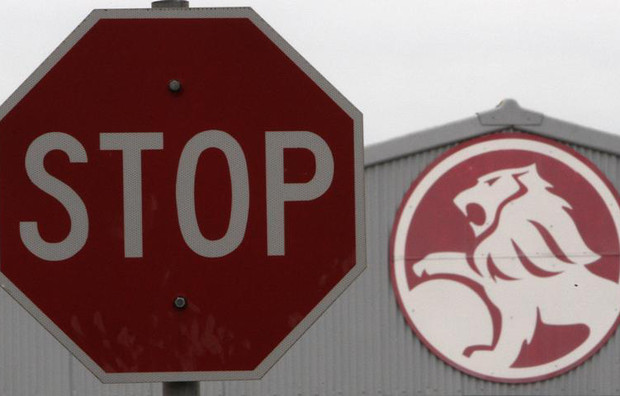 A stop sign is seen near a General Motors Holden storage facility in Melbourne
