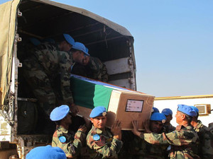 Photo taken on December 20, 2013 released by the UN Mission in South Sudan (UNMISS) shows the remains of two UN soldiers from the Indian Battalion killed in action the previous day being transported to Juba for a memorial ceremony