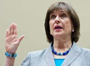 Internal Revenue Service Director of Exempt Organizations Lois Lerner(C) is sworn in, May 22, 2013 in Washington, DC