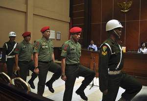 12 Indonesian soldiers on trial over prison attack