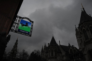 A Lloyds bank sign is pictured outside a branch in central London on March 1, 2013