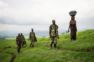 M23 rebels move through hills near Mushaki in eastern DR Congo on November 29, 2012
