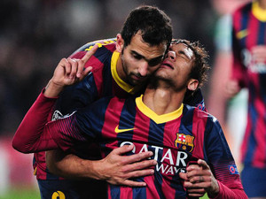 Barcelona's Brazilian forward Neymar (R) celebrates his goal Barcelona's defender Martin Montoya at the Camp Nou stadium in Barcelona on December 11, 2013