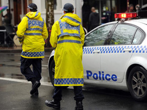 Members of the New South Wales Police Force are seen in Sydney on June 13, 2012