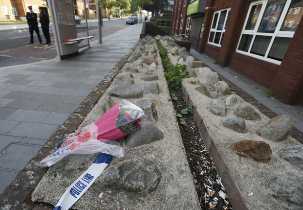 Flowers lie near a crime scene where one man was killed in Woolwich