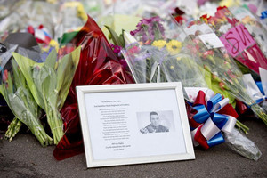 A framed photograph of murdered British soldier Lee Rigby lies amongst floral tributes in London on May 23, 2013