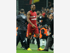 Galatasaray's Didier Drogba from Ivory Coast wears a t-shirt reading