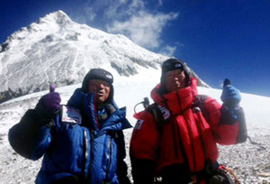 Japanese adventurer Yuichiro Miura, 80, and his son Gota (L) on Mount Everest, May 22, 2013