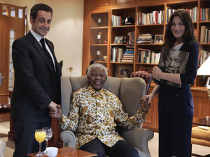 File photo of France's President Sarkozy and his wife Bruni-Sarkozy posing with former South African President Mandela in Johannesburg