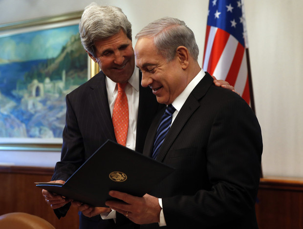 U.S. Secretary of State Kerry gives a present to Israeli PM Netanyahu in Jerusalem