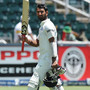 Indian batsman Cheteshwar Pujara (left) walks off the field after being bolwed by South African bowler Jacques Kallis on the fourth day of their Test match in Johannesburg on December 21, 2013