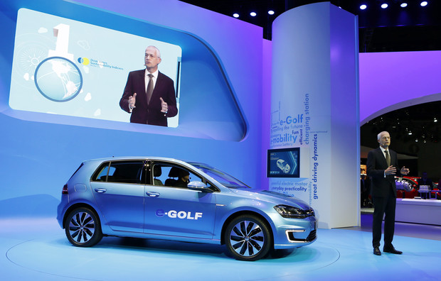 Jonathan Browning introduces the Volkswagen e-Golf electric car at the Los Angeles Auto Show in Los Angeles