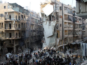 Syrians search for survivors amidst the rubble following an airstrike in the Shaar neighborhood of Aleppo on December 17, 2013
