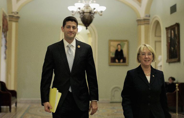 House Budget Committee Chairman Paul Ryan (R-WI) and Senate Budget Committee Chairman Patty Murray (D-WA) walk past the Senate chamber on their way to a press conference to announce a bipartisan budget deal on December 10, 2013
