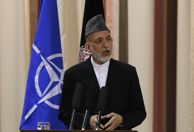 Afghan President Karzai speaks during joint news conference with NATO Secretary General Rasmussen following security handover ceremony at a military academy outside Kabul