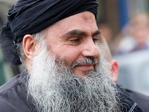 Jordanian cleric Abu Qatada arrives at his home in northwest London, on November 13, 2012