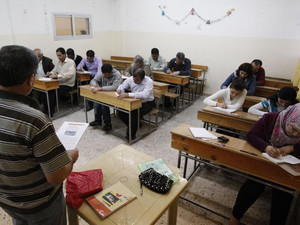 Syrian Kurds practise reading the Kurdish language at a school in Derik