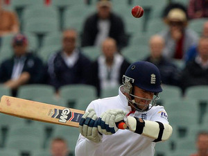 England's Graeme Swann bats against Australia during the last day of the second Ashes cricket Test match in Adelaide on December 9, 2013