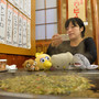 Tour operator Sonoe Azuma takes a picture of stuffed toys during a visit to a restaurant in Tokyo, on October 4, 2013