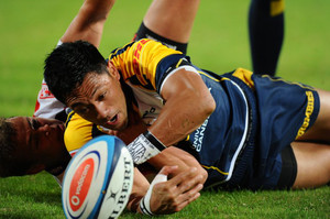 ACT Brumbies flyhalf Christian Lealiifano is tackled during a Super 15 rugby match in Johannesburg on April 27, 2012