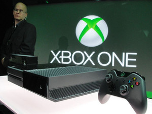 A member of the Microsoft security team watches over the Xbox One console at Microsoft's campus on May 21, 2013