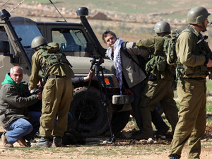 Journalists are arrested by Israeli soldiers south of the West Bank city of Hebron on February 9, 2013