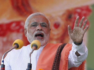 Hindu nationalist Modi, prime ministerial candidate for India's main opposition BJP, addresses a rally in Agra