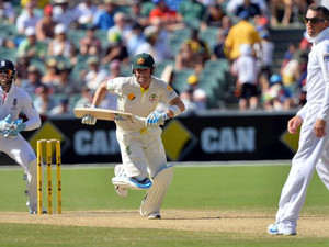 Australia's batsman Michael Clarke (C) runs for a quick single as England's wicketkeeper Matt Prior (L) looks on during the third day of the second Ashes cricket Test match in Adelaide on December 7, 2013