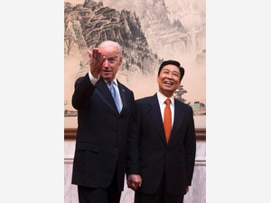 US Vice President Joe Biden (L) walks with his Chinese counterpart Li Yuanchao to the luncheon room at the Diaoyutai State Guesthouse in Beijing on December 5, 2013