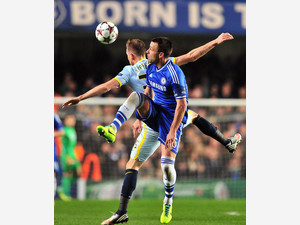 Chelsea's English defender John Terry (R) vies with Steaua Bucharest's Italian striker Federico Piovaccari (L) at Stamford Bridge on December 11, 2013