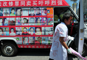 A van bears pictures of missing children, in Fuzhou, eastern China on May 2, 2013