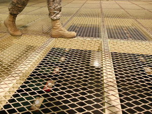 A U.S. soldier walks above prison cells at a new detention centre at the U.S. Bagram Air Base