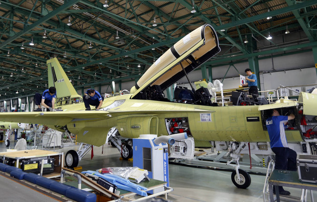 Engineers assemble a FA-50, South Korea's first home-built light fighter, at an assembly plant of the Korea Aerospace Industries (KAI) in Sacheon
