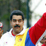 Venezuela's President Nicolas Maduro gestures to supporters before voting during municipal elections in Caracas