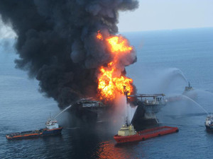 This US Coast Guard image released on April 22, 2010 shows fire boat response crews as they battle the blazing remnants of the off shore oil rig Deepwater Horizon April 21, 2010