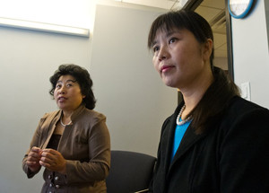 Ma Chunmei (R) and Wang Chunying are interviewed at the AFP offices in Washington, DC, on April 30, 2013