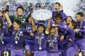 Sanfrecce Hiroshima players celebrating winning their first J-League title after a 4-1 victory over Cerezo Osaka