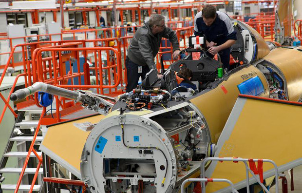 EADS employees assemble a Eurofighter plane at a production line in Manching, southern Germany, on February 28, 2013
