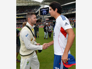 Alastair Cook (right) congratulates Michael Clarke in Adelaide on December 9, 2013 after Australia defeated England in the second Ashes Test