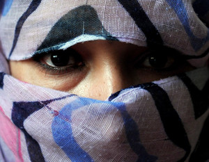 A former Afghan prisoner poses for a photograph at a shelter for women in Kabul, on October 12, 2011