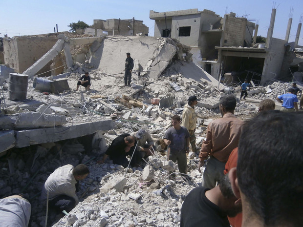 Civilians search for survivors under rubble after what activists said was shelling by forces loyal to Syria's President Bashar al-Assad, in Qusair town near Homs