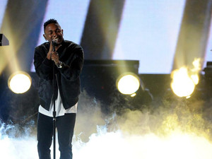 Rapper Kendrick Lamar performs onstage during the 2013 American Music Awards at Nokia Theatre L.A. Live on November 24, 2013 in Los Angeles, California