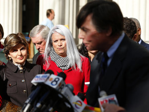 Jackson and her attorney Allred listen to former San Diego Mayor Filner's attorney Coughlan after Filner's sentencing hearing in San Diego