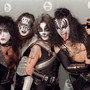 Members of the rock group 'Kiss' pose for photos at the 38th annual Grammy Awards in Los Angeles, California, on February 28, 1996