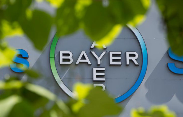 The logo of German pharmaceutical giant Bayer appears on an overpass at its Berlin headquarters on July 24, 2013