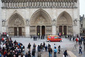 People watch as French police cordon off the front of Paris' Notre Dame Cathedral on May 21, 2013