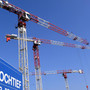 Hochtief builds up stake in Leighton of Australia