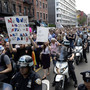 Thousands protest after gay man's murder in New York