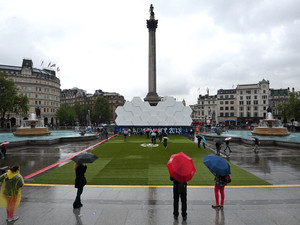 People visit the Champions League fan zone in Trafalgar Square in central London on May 24, 2013