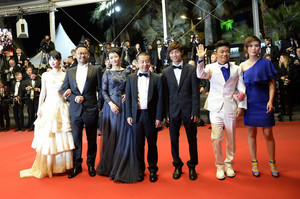 "The cast and director of ""Tian Zhu Ding"" on the red carpet at Cannes on May 17, 2013"